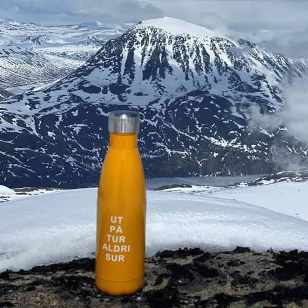 Bilde av Termoflaske, gul. Ut på tur aldri sur.