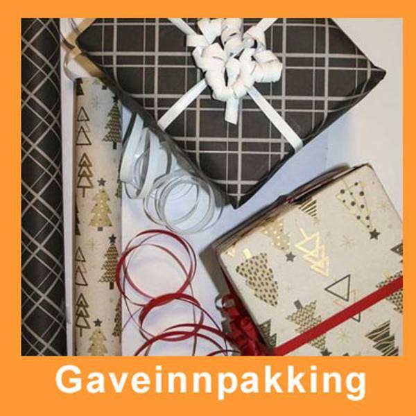 nnpakking av gaver. Velg mellom julepapir og standard papir